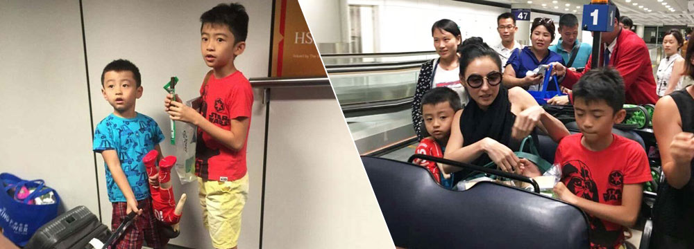 张柏芝母子现身机场 Quintus帮拖行李箱超懂事