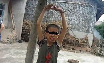 小孩因偷摘葡萄被葡萄园主人吊葡萄架下
