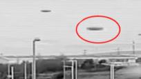 圆状UFO飞进日本村庄 恰巧被公路上的监控拍了下来