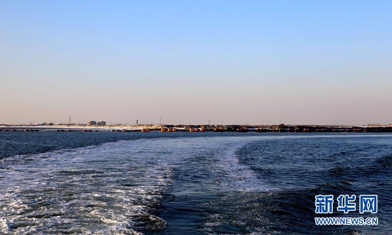 唐山湾:晨夕享耀日 雪夜醉月岛