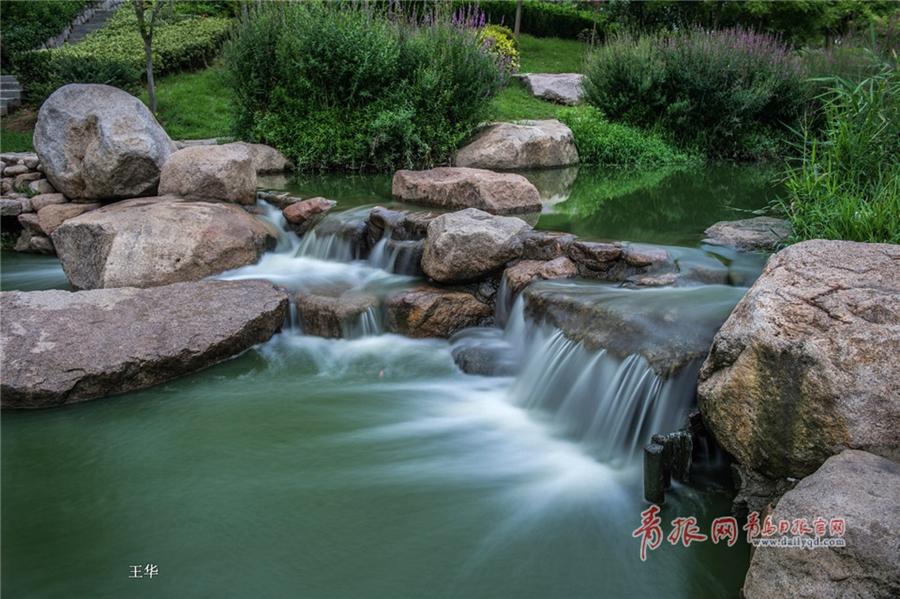 """慢门拍摄雨后李村河:""""小瀑布""""曼妙似纱美景怡人"""