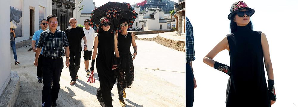 杨丽萍穿民族风长裙参观考察 获助理打伞气势足