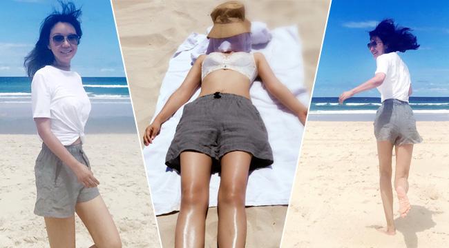 闫妮沙滩享受日光浴 46岁保养有致身材好