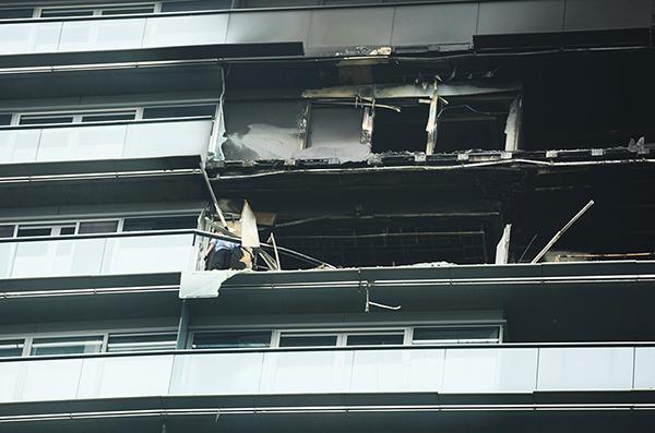 杭州豪宅纵火案:女主人曾借10万给保姆 (组图)