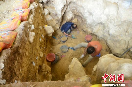 广西发现1.6万年前人类头骨化石出土石制品万余件