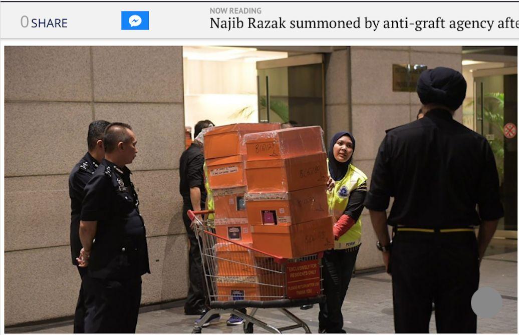 马来西亚前总理被抄家 警方带走284箱名牌包包