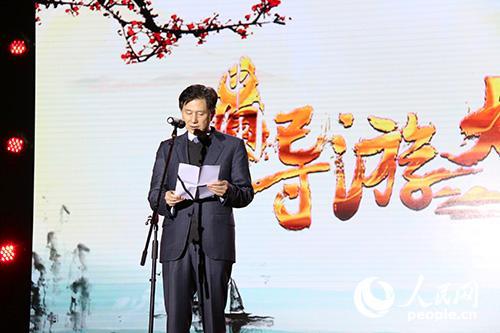 国家旅游局副局长王晓峰上台致辞。实习生王赵童摄