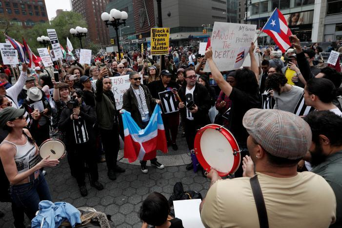 Demonstrators gather during a May Day protest in New York