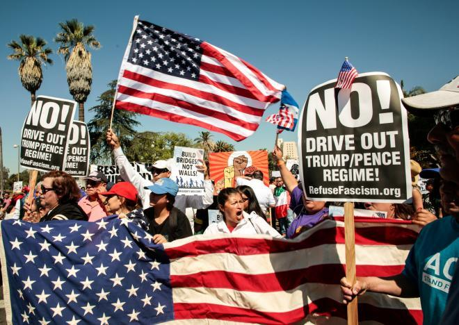 People participate in a May Day protest march in Los Angeles