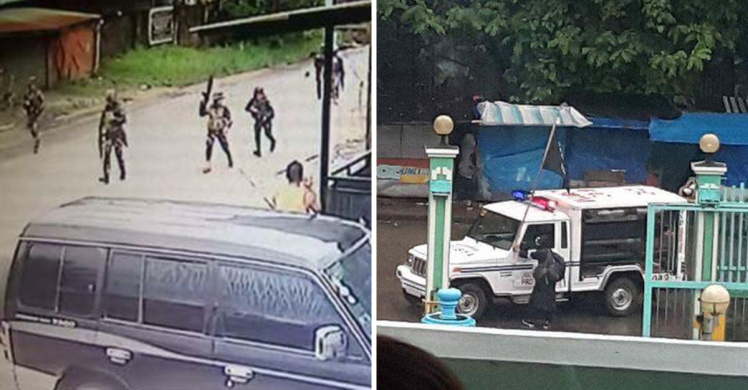 Isis militants 'raise black flag' as they battle for control of city in Philippines