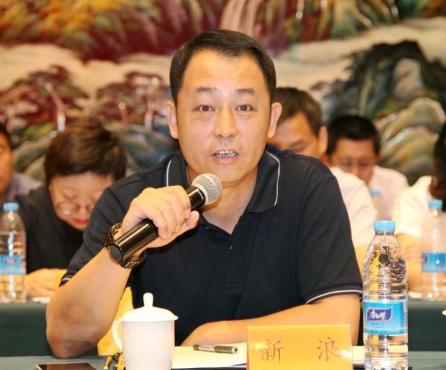 新浪党委书记,工会主席傅毅同志在会上发言图片