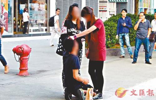 男士被女友打骂。图片来源:香港《文汇报》