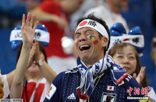 资料图片:观看世界杯比赛的日本球迷。