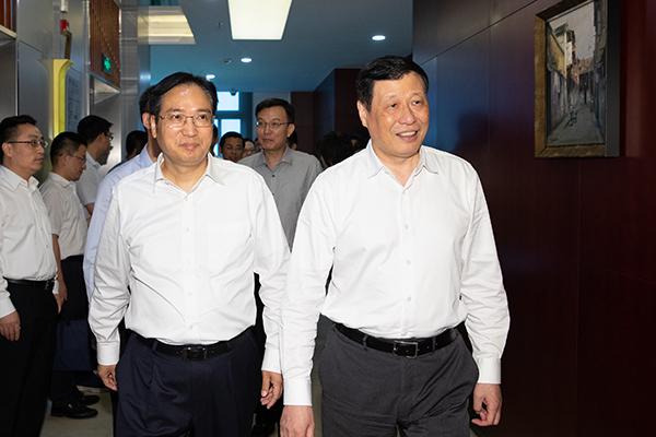 把上海建成国资国企综合改革示范区,应勇调研国际、国盛集团