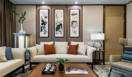 沙發背景墻的國畫與現代中式家具交相呼應,將傳統中式的禪意和韻味更加凸顯。