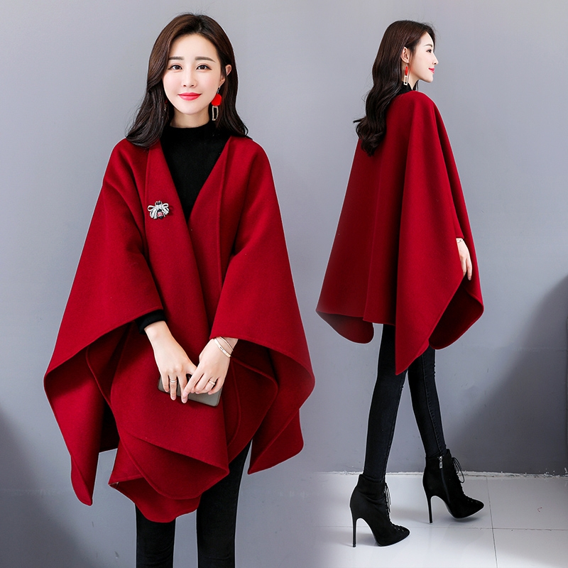 披肩斗篷妮子大衣時尚寬松版型,簡約的設計擺脫單調與深沉,透露優雅圖片